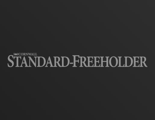 Cornwall Standard-Freeholder logo on dark gradient background