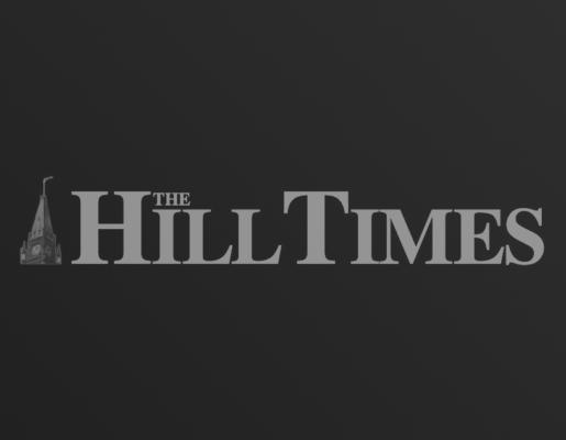 The Hill Times logo on dark gradient background
