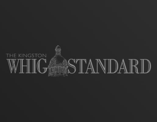 The Kingston Whig Standard logo on dark gradient background